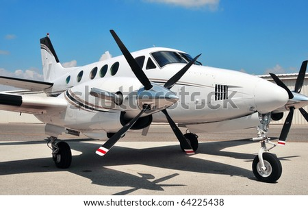 Twin engine airplane on the tarmac - stock photo