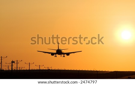 Twin engine passenger jet coming in for a landing - stock photo