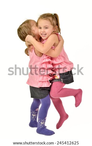 Twin Girls are celebrating, jumping and hugging like happy children - stock photo