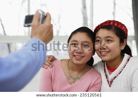 Twin Girls Getting Picture Taken - stock photo