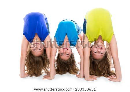 twin kid sisters girls friends playing as flexible contortionist happy on white background - stock photo