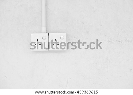 Twin power socket on a blank concrete wall. Processed in monochrome.  - stock photo