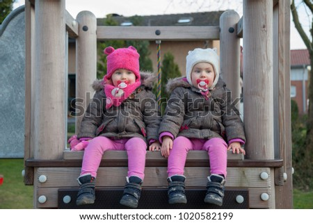 twin sisters at the playground