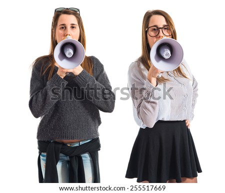 Twin sisters shouting over white background
