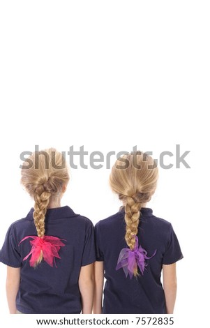 twin sisters with braided hair - stock photo