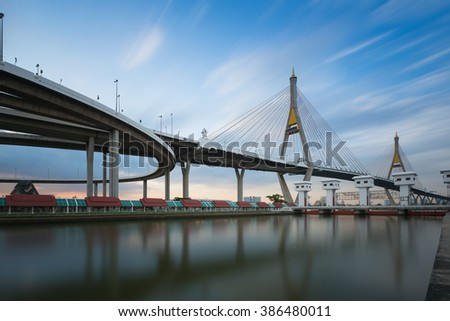 Twin suspension waterfront with moving blue sky cloud - stock photo