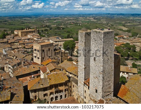 Twin towers in a medieval city. San Gimignano, Tuscany, Italy. - stock photo