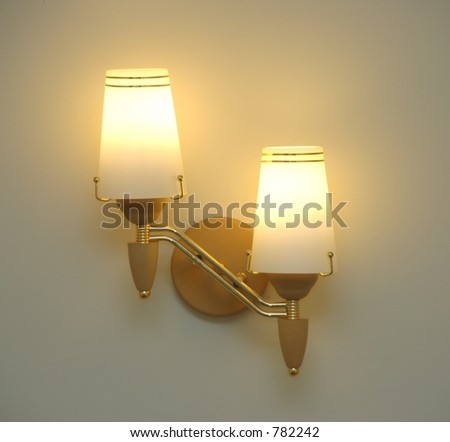 Twin wall lamps lit up
