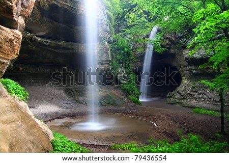 Twin waterfalls crash into Tonti Canyon on a spring day at Starved Rock State Park - stock photo