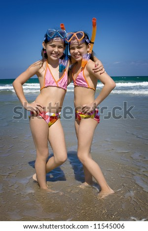 Twins at the beach - stock photo