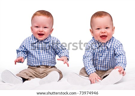 Twins boys sit isolated on the white - stock photo