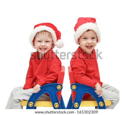 twins childs in Santa Claus - stock photo