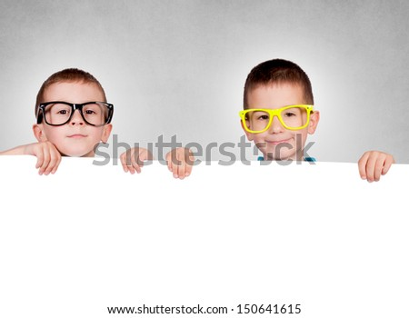 Twins holding blank red poster with blank space - stock photo