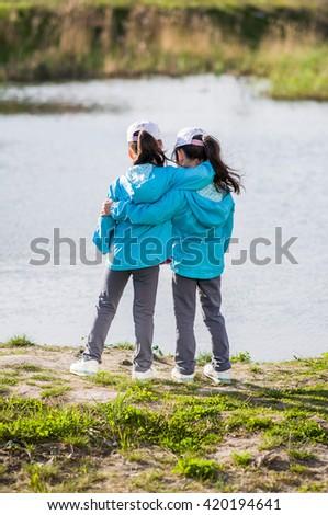 Twins hugging - stock photo