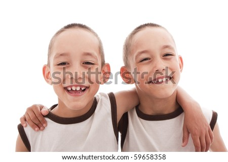twins isolated on white happy together