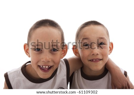 twins isolated on white happy together - stock photo