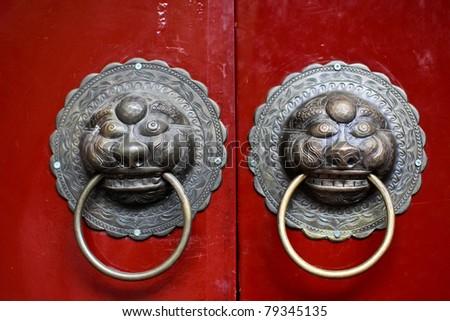 Twins-Lion Door Knocker - stock photo