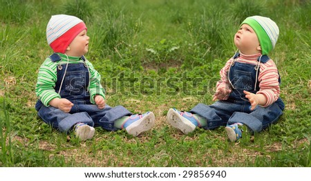 Twins outdoors. - stock photo