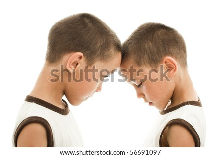 twins playing aggressive and confused persons against each other - stock photo