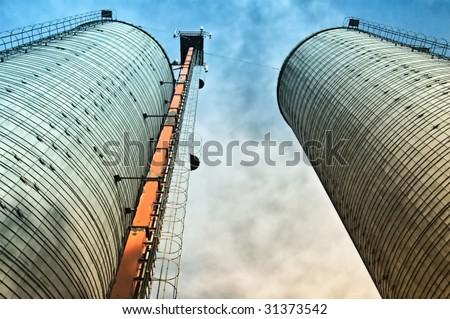twins silo with sky - stock photo