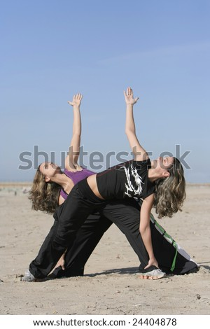 twins working out in the beach - stock photo