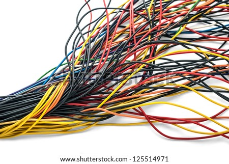Twisted bundle of computer multicolored cables isolated on white background. All inscriptions (company names and technical information) have been carefully removed from the plastic sleeves.