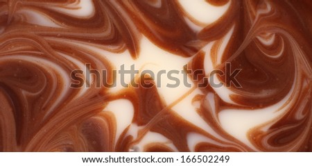 Twisted chocolate mixed texture. Close up. Whole background. - stock photo