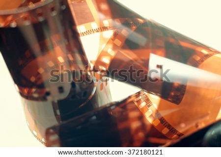 Twisted film from the camera, vintage toning - stock photo
