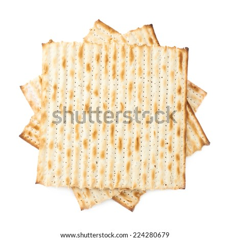 Twisted pile of multiple machine made matza flatbreads, composition isolated over the white background, top view above - stock photo