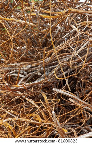 Twisted Rebar A large pile of twisted and deformed rebar collected from the ruins of a demolished building - stock photo