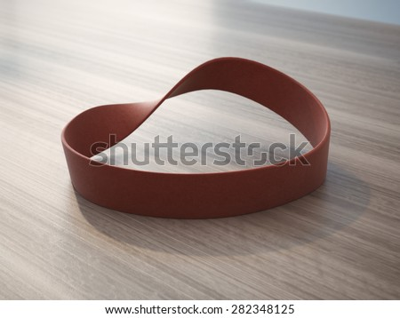 Twisted red rubber wrist band  - stock photo