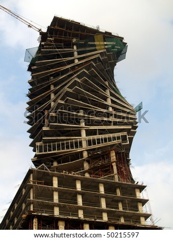 twisted sky scraper under construction in Latin America.  This height of this now completed building is 210 M - stock photo