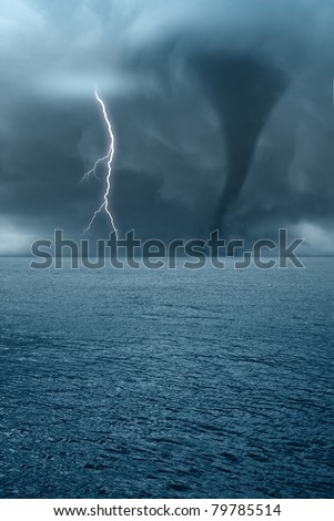 twister and lightning over the ocean - stock photo