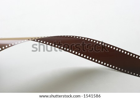 Twisting camera film - stock photo