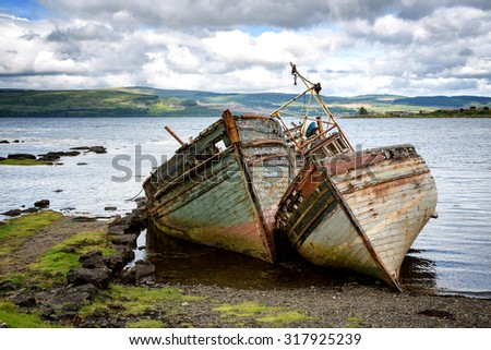 Two abandoned fishing boats in Salen Sound, Isle of Mull, Inner Hebrides, Scotland.  - stock photo