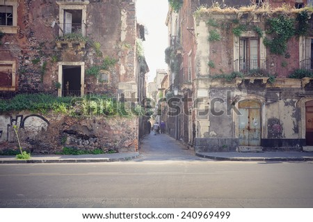 Two abandoned houses on the street of Catania. Italy. - stock photo