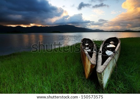Two abandoned ships with water lake with sunsrise in Khiri Than Dam,Chanthaburi of Thailand - stock photo