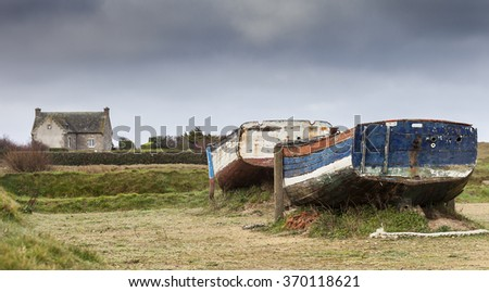 Two abandoned unused fishing boats in france, near the atlantic
