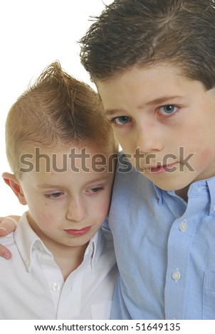 Two abused children holding each other isolated on white. - stock photo