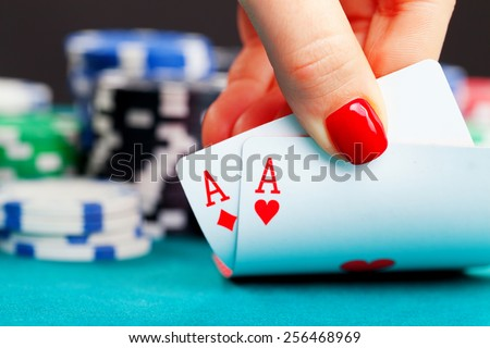 Two aces and gambling chips - stock photo