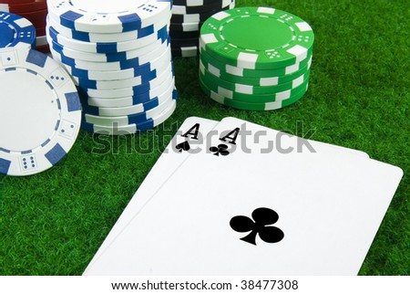 two aces and some pokerchips - stock photo