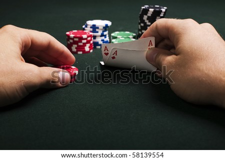 Two aces in hand. And chips ready for betting - stock photo