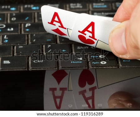 Two aces on a computer keyboard with a reflection. - stock photo