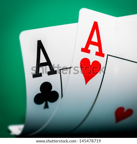 two aces on a green table casino - stock photo