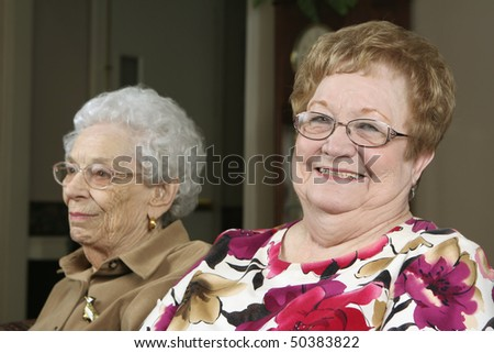Two active seniors at an assisted living facility - stock photo