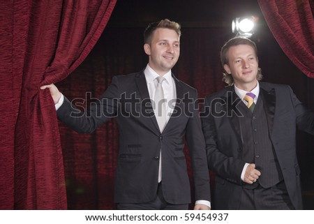 two actors in spotlight on the stage - stock photo