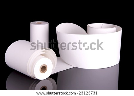 Two adding machine tapes.  One is unrolled and ready for your text.  Isolated on black.
