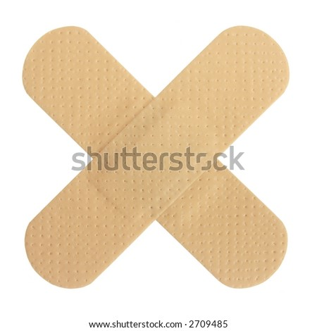 Two adhesive bandages forming an 'X' isolated on white. - stock photo