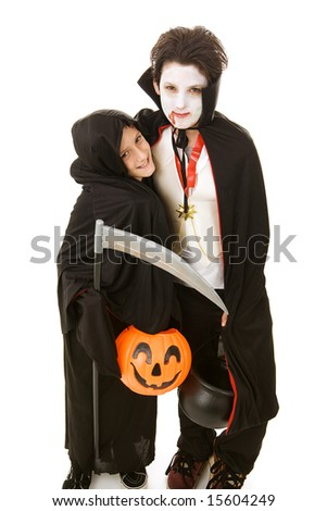 Two adorable boys dressed in their halloween costumes.  Full body isolated on white. - stock photo