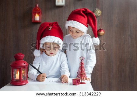 Two adorable boys, writing letter to Santa - stock photo